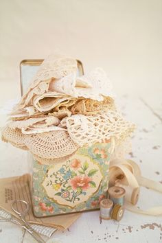 Some of my favorite things...lace, tins and spools of old thread!