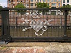 Cross Stitch on fence in the Warehouse District, New Wandrahm, Hamburg, Germany by Miss Cross Stitch.