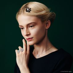 """Van Cleef & Arpels new """"Jewelry and Watches"""" catalog. Cosmos Between the Finger Ring, white gold and diamonds. Two Butterfly pendant, white gold, round and marquise-cut diamonds. Rose de Noël clip-pendant, white gold, grey mother-of-pearl and diamonds."""