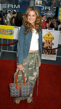 The time she paired a Coach bag with another piece of iconic early Y2K clothing: drawstring camo cargo pants: