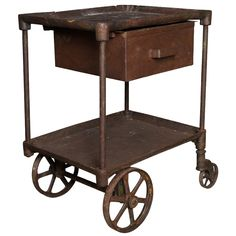 Vintage Iron Table / Cart  : 1stdibs-.  This would make a GREAT microwave cart!