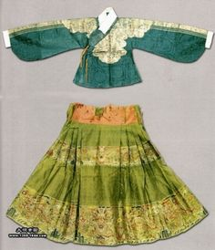 1370ADM - Ming Dynasty Clothing. Costume in the Ming Dynasty was decorated with various striking adornments made of gold, jade and pearl, etc. A special adornment was a golden chain hung with nipper, toothpick, ear pick and small knife, articles that were often used by women in their daily life.
