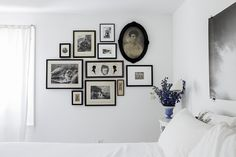 white walls and bedroom, black gallery wall frames