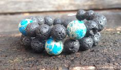 Lava and Glass Bead Memory Wire Bracelet by themermaidssinging