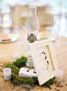 Annd camera, great for candid pics! moss + hurricane....maybe not the moss, but something to add to the table besides just an oil lamp