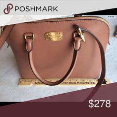 Michael Kors Large Dome Satchel Leather Bag Open to spicy 🌶 offers. Authentic Michael Kors Cindy Large Dome Satchel Leather bag. The color is a ballet pink. The shade of pink is opaque pink. It's really beautiful. Kinda sad I had to sell it but bought it full price. Let me know, if you have any offers. It's brand new. It never actually left my closet. Pink isn't really my color. Pockets for cellphone, wallet, and total of 4 medium side pockets. They are about 5.5 inches deep. One of the…