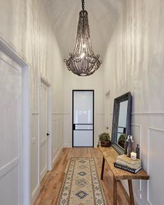 hallway is a complete showstopper. That pendant, the steel door frame, the beautiful carpet runner! Shop the look at The Block Shop now (link in bio - head to 'See the Rooms') Hallway Decorating, Entryway Decor, Entryway Lighting, Modern Entryway, Entryway Ideas, Decorating Tips, Style At Home, Feng Shui, Entry Hallway