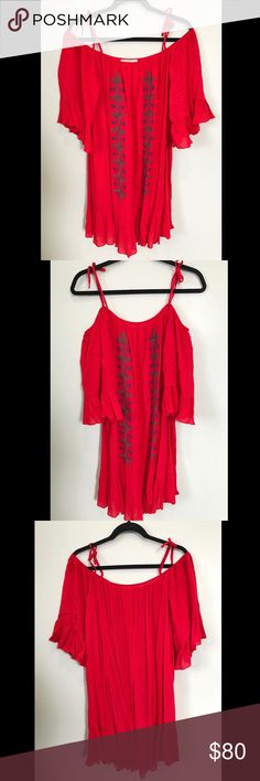 Hazel Embroidered Cold Shoulder Dress Hazel embroidered cold shoulder dress. Off the shoulder style with shoulder ties. Three quarter sleeves. Ruffled hem. Beautiful red embroidered design. Flows beautifully. 100% rayon. Dry clean only. NWOT. Hazel Dresses Mini
