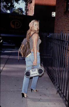 Mariah Carey holding a radio