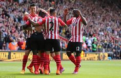 Southampton players crowd around Mane after the Senegalese winger found the net for the th...
