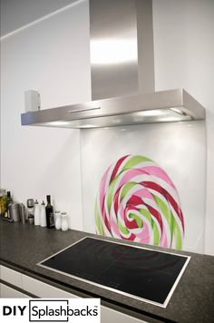 Candy Swirl printed glass splashback. All of our splashbacks are made from toughened safety glass, are available in any size, and come with a 7 year warranty. Visit diysplashbacks.co.uk to discover more.