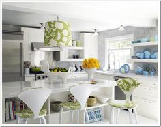I've been quite enamored with white kitchens lately.