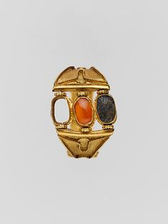 Gold ring: 3 box settings on the bezel and cloisons on the sides Period: Archaic Date: 6th century B.C. Culture: Cypriot