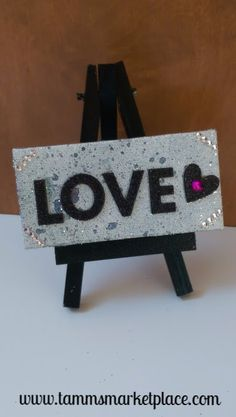 """""""Love"""" mini canvas art with easel is made from Mixed Media techniques. The canvas measures approximately 2""""x4"""" and is signed by the artist on the backside. Easel is included. Mixed Media is a term tha"""