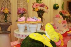 CatchMyParty-butterflyshower-like the cupcake holders-mini flower pots?