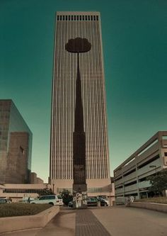 Downtown Tulsa Treasures: The Artificial Cloud is dwarfed by downtown Tulsa's tallest skyscraper, the BOK Tower.