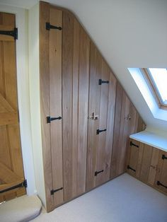 loft storage - more interesting than just plain white doors?