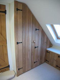 loft storage - more interesting than just plain white doors?