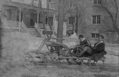 An Early Snowmobile: In 1916 Jose Velez of Port Henry, NY invented this unique snowmobile; he is shown here giving a ride to Pauline Gregory, who later became his wife. Jose removed the front wheel from a Yale motorcycle, and attached a column from the front of the sled to a steering wheel. It worked fine on level ground, but had some difficulty on the Port Henry hills.
