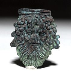 "Rome, 200 BCE to 200 CE. This is a cast bronze applique in the form of a Silenus head. Silenus is an older man who was a friend of Dionysus in Graeco-Roman mythology and whose image was popular as a symbol of raucous drinking and partying. An applique like this would have been applied decoratively to some kind of vessel. Size: 1.9"" L x 1.6"" W (4.8 cm x 4.1 cm). <BR><BR> Provenance: Ex-private M. Reniger collection, Chicago, IL.<BR><BR>  All items legal to buy/sell under U.S. Statute…"