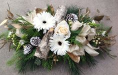 Fresh floral centrepiece for your holiday table with woodsy accents. Designed by CB Flower Boutique