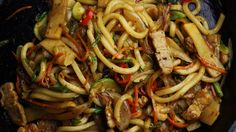 Stir Fried Udon Noodles-substitute red pepper flakes for red chili peppers.  Sambal can be substituted with a mix of sriracha and MaePloy sauce.