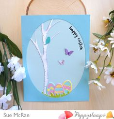 Hi everyone, Sue here with an Easter card I created with a few of the new dies. I started with a light blue card base and then die cut an oval from a darker blue card stock using the Memory Box Stitched Oval Layers. This way I could place my die cuts as I went along to see how they fit into the scene. I die cut the Swaying Birch from white wood grain card stock that I inked along the edges with grey ink and a finger dauber, this helps to add some depth to the tree. For the...