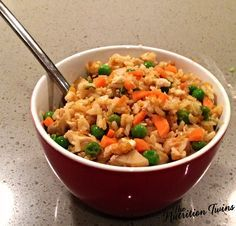 Chicken Fried Rice | Lightened Up Comfort Food | Only 246 Calories | 19 Grams Protein to Keep you Satisfied | Delicious Way to Get Veggies | For MORE RECIPES, fitness & nutrition tips please SIGN UP for our FREE NEWSLETTER www.NutritionTwins.com