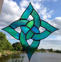 APS:  This pattern was drawn by my husband and is an exclusive to Sweveneers. It is not to be reproduced by other stained glass artist. Copyright 2013. Green and Blue Square Celtic Knot Sun Catcher on Etsy, $30.00