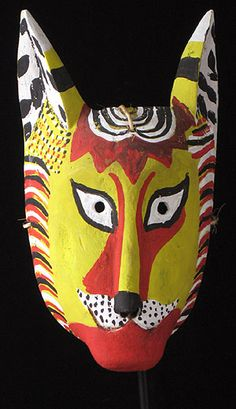 Yellow Cat Mask  Suchitlán, Colima    13 Inches, carved wood with paint    Carved by Herminio Candelario, his work has been documented in the book by Lechuga and Sayer, Mask Arts of Mexico p.63, and in fact a mask by this carver is on the cover of the book. He is also one of the five carvers honored in Great Masters of Mexican Folk Art, pages 242-3. This mask was collected directly from the carver by Dinah Gaston. It has been lightly used.    In the dance of the Morenos/ Dance of Los…