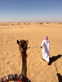 We went for a little ride through the desert on a camel. #dubai #desert #safari