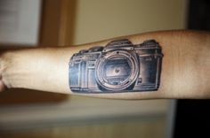 Second tattoo of my very first film camera. The reason it doesn't have the lens on is because that the camera only lasted 2 weeks until the shutter broke. I shot 2 rolls of film and those are still some of my favorite images that i've taken. I want to say it was that camera that made want to pursue photography as a career.  It was done by Zack Spurlock, Anonymous Tattoo, Savannah, GA