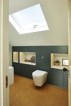 If you're designing a bathroom to suit a loft conversion and are looking to tackle an awkward space, consider building handy recesses into the eaves. # Loft conversions: 23 expert tips for getting it right Attic Shower, Small Attic Bathroom, Upstairs Bathrooms, Small Attic Room, Loft Ensuite, Loft Bathroom, Bathroom Storage, Bathroom Bin, Funny Bathroom