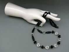 Long 1920s/30s Art Deco necklace with facetted black and clear glass beads, Czechoslovakia - Glitzmuseum