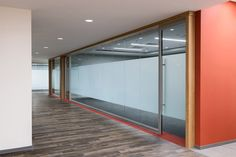 Glass Partition Walls #VIEW-WALL-1  The VIEW series create aesthetically pleasing glass room dividers for an elegant office design. Its rounded aluminum frame creates a thin profile glass partitioning. Floor to ceiling glass allows transparency and light-filled space while achieving visual separation and acoustical privacy. Floor leveling is built-in to adjust to its site conditions. The wall system is quickly demountable to accommodate any changing needs.