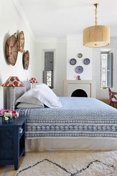 Blue & White Bedroom - An elegant house combining English country house style with traditional Moroccan elements - real homes on HOUSE by House & Garden.