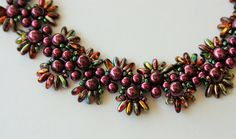 Bracelet with burgundy pearls and multi-color rizos. CJRblings on Etsy.