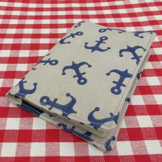 This is a handmade fabric passport cover. It measures x x This cover is made to fit a European Union, US or UK passport. The fabric used is a medium weight cotton with a nautical design. It is lined with a hearts design cotton c. Nautical Design, Passport Cover, Cotton Canvas, Coin Purse, Patches, Fabric, Sleeves, Handmade, Travel