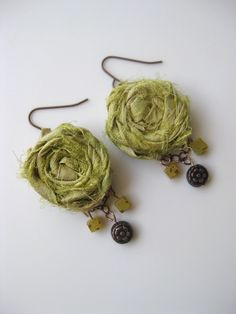 Fresh - Silk sari ribbon rosette earrings in Spring Green with hanging green and copper beads...a versatile pop of color for your wardrobe. $12.99, via Etsy.