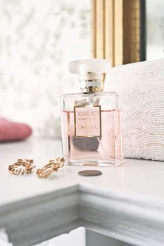 Pink chanel perfume bottle iPhone wallpaper