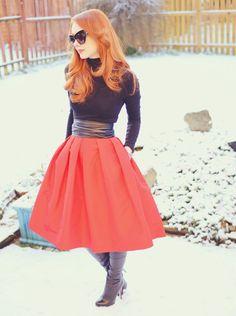 dark turtleneck, bright skirt with pockets, black boots