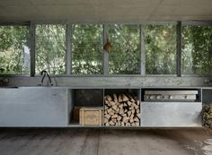 act_romegialli transformation of disused garage into garden pavilion, simple cooking area with thin counter of galvanized steel, Remodelista...