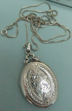 Vintage Sterling Silver Locket on Chain Large Locket. $248.88, via Etsy.