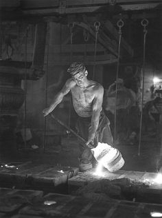 Back breaking labor. 1970, a foundryman pours molten iron into a mold at the (now defunct) Portland Stove Foundry in Portland, Maine.