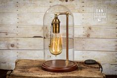 *** Watch Product Demo Video (Copy & Paste): https://vimeo.com/dancordero/belljar1 Check out my smaller Edison Bell Jar at: www.dancordero.com This is another beautiful walnut base glass bell jar. This Edison Lamp Bell Jar features an impressive dome height of 11 and base diameter of 5.5. Custom paint job steel tubing is accented with adjustable swivel polished BRASS wing nuts. An Antique Brass pull chain socket completes this piece! Looking for a lamp that add...