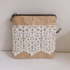 Paper pouch with lace.