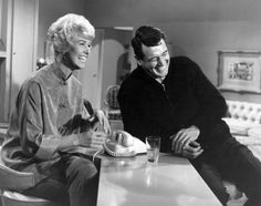 Rock Hudson and Doris Day laughing out loud on set