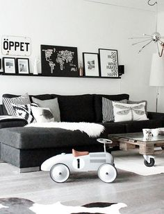 Paint your walls white, add a black couch, your favorite black and white images, then go wild with corrdinating pillows and accessories.. Norwegian Living Rooms by decor8, via Flickr #blackwhitedecor