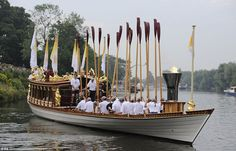 Handout photo issued by LOCOG of the Olympic Flame on the Royal rowbarge Gloriana