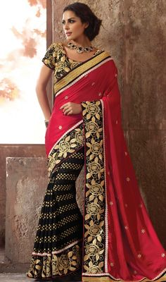 This crimson & black viscose satin saree is including the lovely glamorous displaying the sense of cute and graceful. The ethnic resham & stones work at the clothing adds a sign of attractiveness statement with your look. #fancyhalfnhalfsari #alluringdesignsaree #eveningsarees